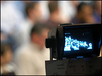 A camera focuses on an audience in a BBC studio