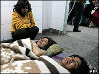 Injured women lie in hospital in Ica, Peru