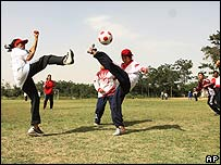 Girls play football during a tournament in Kabul in July