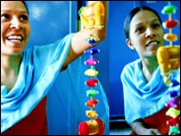 Indian women making handicrafts