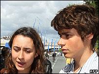 Melanie and Lorenzo Betancourt speaking to reporters