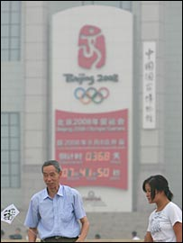 A smog-shrouded Olympic countdown clock in Beijing