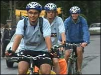 Tom Tapper on his bicycle with friends following