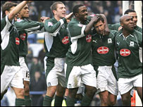 Plymouth players celebrate