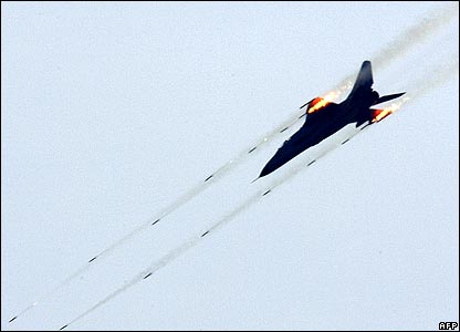 Fighter plane firing guns