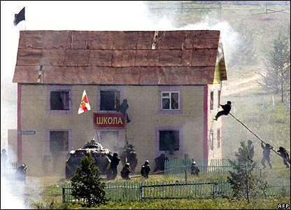 Troops storming building