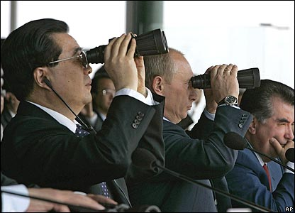 President Hu and President Putin watch exercises through binoculars