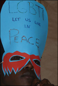 A gay activist in Uganda wearing a mask