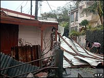 Local residents inspect a damaged building in Martinique