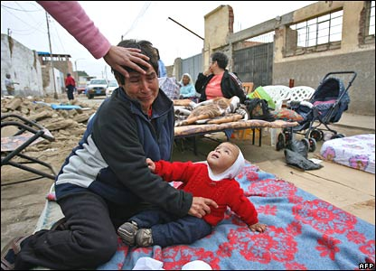 A mother and child are left shaken by another quake at a refugee camp in Peru