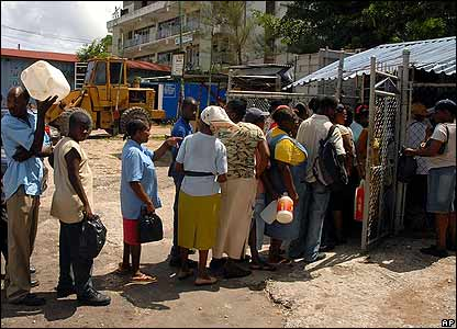 People line up in Kingston, Jamaica, to buy in kerosene on 17 August
