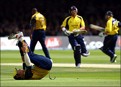 Hampshire captain Shane Warne (on the floor) misses the ball