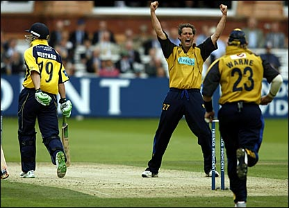 Durham's Phil Mustard (left) departs for 49 while Hampshire's James Bruce (centre) and Shane Warne celebrate