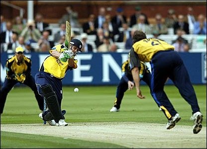 Phil Mustard hits a boundary off James Bruce