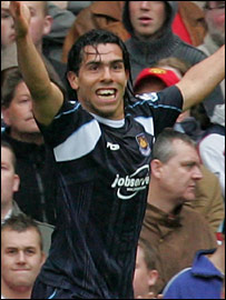 Tevez celebrates his winner against Manchester United