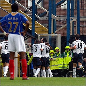 Bolton players celebrate taking the lead at Fratton Park
