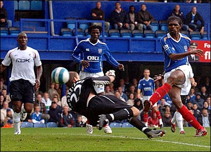 Kanu (right) lifts the ball over Bolton keeper Jussi Jaaskelainen to score Portsmouth's equaliser