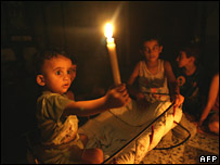 A Palestinian family in a blackout-struck area of Gaza City