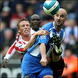 Sunderland's Danny Collins hauls down Antoine Sibierski