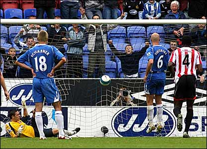 Antoine Sibierski scores Wigan's third from the penalty spot