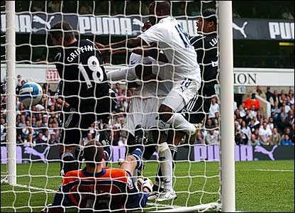 Darren Bent (centre) scramble home Tottenham's fourth goal