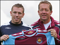Alan Curbishley (right) and Craig Bellamy pose for the cameras