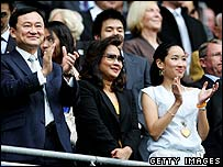 Thaksin Shinawatra and family applaud at a Manchester City game in the UK on 19 August