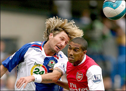 Gael Glichy is challenged by Robbie Savage
