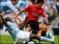 Micah Richards tackles Carlos Tevez