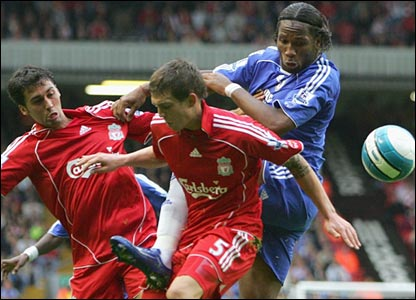 Didier Drogba is thwarted by Daniel Agger and Alvaro Arbeloa
