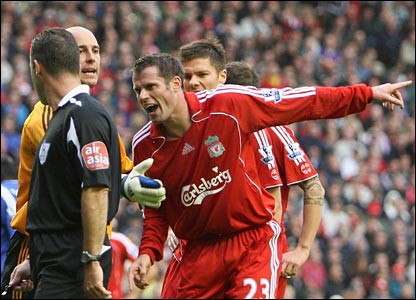 Liverpool's Jamie Carragher protests to referee Rob Styles