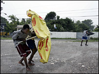Two Jamaican boys brave the storm