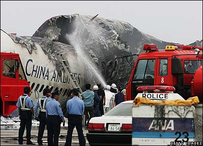 Firefighters douse flames of China Airlines plane at Naha airport in Okinawa, Japan - 20/08/07