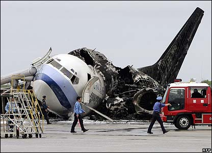 Burnt-out China Airlines plane at Naha airport in Okinawa, Japan - 20/08/07