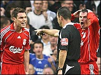 Liverpool's Jamie Carragher (right) and Steve Finnan express their disbelief after referee Rob Styles awards a dubious penalty to Chelsea