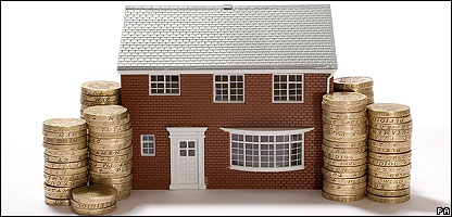 Model house with pound coins