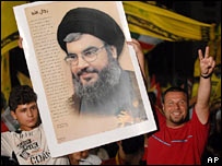 Hezbollah' supporters hold a picture of leader Sheik Hassan Nasrallah on first anniversary of Lebanon war