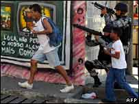 Soldiers and passers-by in Alemao shantytown in Rio de Janeiro