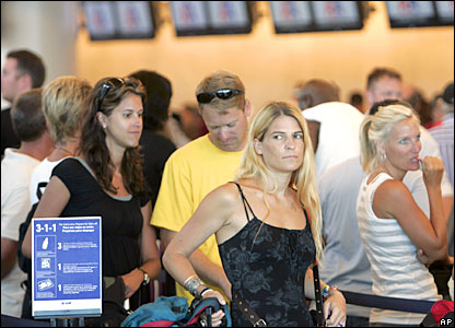 Tourists wait to evacuate from Cancun's international airport