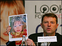 Gerry McCann holds up a photograph of his missing daughter Madeleine during a press conference in June, 2007.