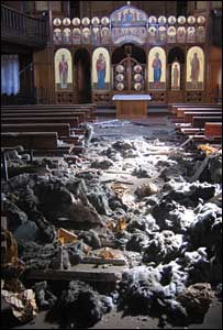 Damage in cathedral from falling ceiling panel