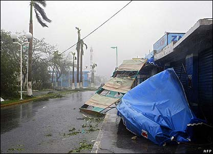 Marquees and signs are brought down in a street of Chetumal, Mexico