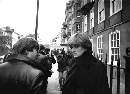 Lady Diana Spencer surrounded by press photographers shortly before the announcement of her engagement to Prince Charles.
