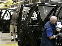 Workers at a Ford car plant in Michigan (file picture)