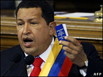 Venezuelan President Hugo Chavez holds a copy of the constitution