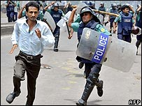 Policeman chases student in Dhaka