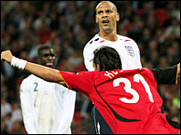 England defender Rio Ferdinand watches on as Kuranyi equalises