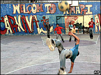 Palestinian children play football in the West Bank town of Ramallah