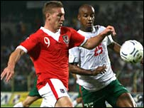 Wales striker Freddy Eastwood takes on the Bulgaria defence