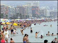A crowded Mediterranean beach on the Costa del Sol
